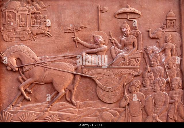 Bhagavad Gita engraved on a Hindu temple : Krishna driving Arjuna's chariot Vrindavan. India. - Stock Image