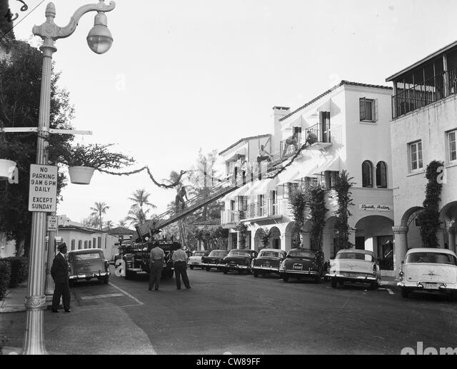 Christmas decorations out up on Worth Avenue by the Fire Department, Palm Beach, Florida, ca 1955 - Stock Image