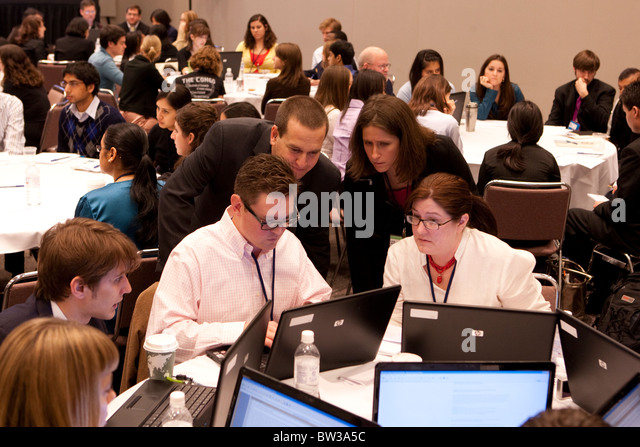 Invited Texas college students work in groups on social issues at Bill Clinton's Global Initiative University - Stock Image