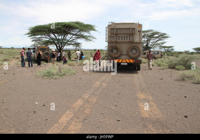 MARSABIT, KENYA - May 17.  Tourist on the Nairobi to Lake Turkana road, stop in the Chalbi desert a few kilometres - Stock Image