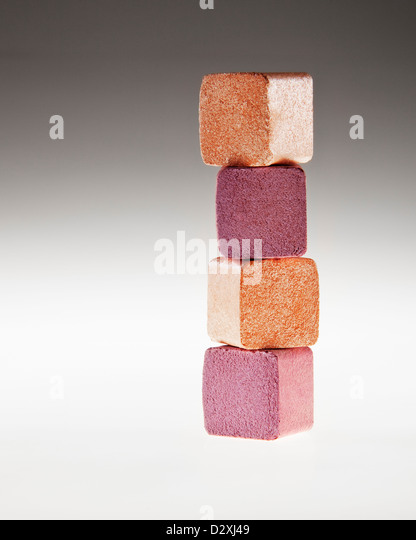 Close up of stacked gold and pink eyeshadow cubes - Stock Image