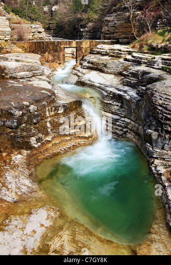A natural pool, called 'Kolymbithres' or 'Ovidres' by the locals, close to Papingo village in Zagori - Stock Image