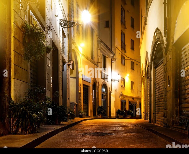 Small beautiful street of Florence at night - Stock Image