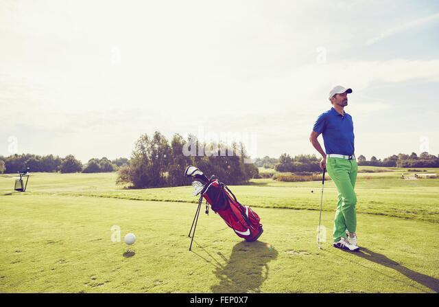 Golfer beside golf bag on course, Korschenbroich, Dusseldorf, Germany - Stock Image