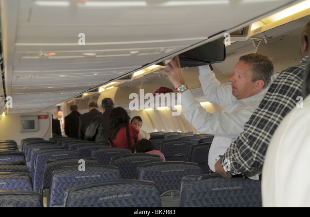 Washington DC Ronald Reagan Washington National Airport DCA American Airlines commercial airliner jet cabin man - Stock Image