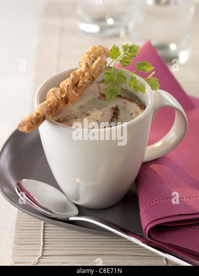 Cream of mushroom and pork soup - Stock Image
