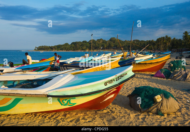 Newer post 2004 tsunami foreign-donated fishing boats on this popular surf beach, Arugam Bay, Eastern Province, - Stock Image