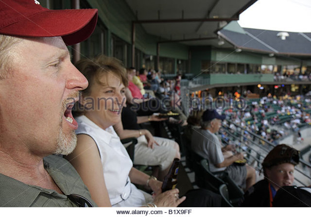 Arkansas North Little Rock Dickey Stephens Park minor league baseball Arkansas Travelers man woman stadium ballpark - Stock Image