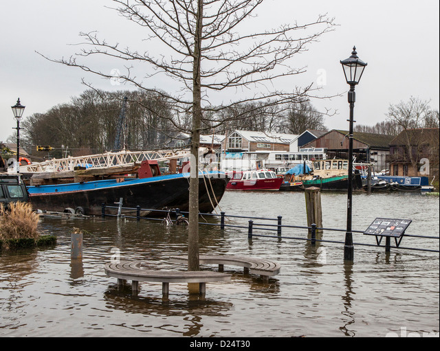 River Thames overflows its banks at high tide - Twickenham UK - Stock Image