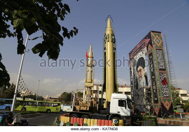 Tehran, Iran. 27th Sep, 2017. Sejjil (L) and Qadr-H medium range ballistic missiles are displayed next to a portrait - Stock Image