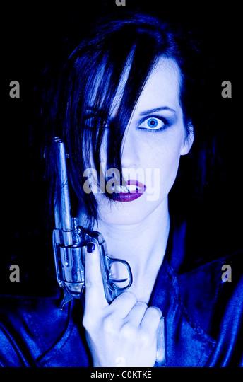 Woman with gun - Stock Image