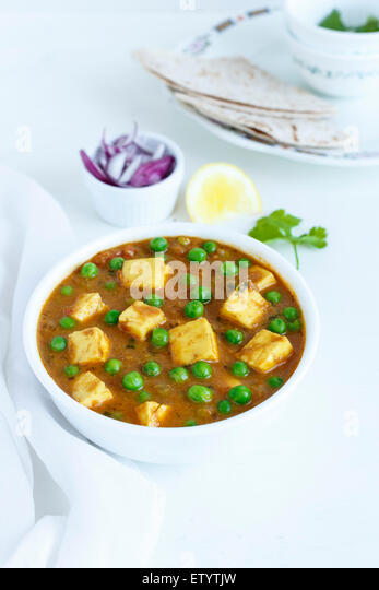 Paneer Mutter , Indian Food , India Cottage cheese and Peas immersed in an Onion Tomato Gravy - Stock-Bilder