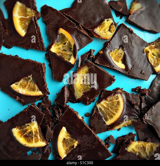Dark chocolate with dried oranges. - Stock Image