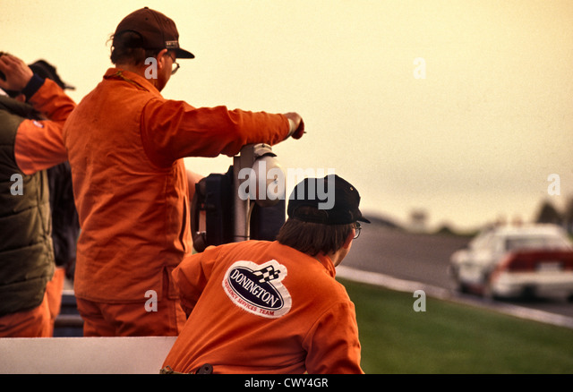 Track Marshals at the1991 Donnington DTM touring car race - Stock Image