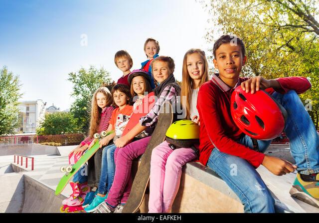 Group of international children with skateboards - Stock-Bilder