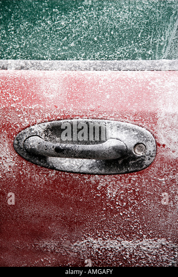 Frozen car after a winter blizzard with copy space for text - Stock Image