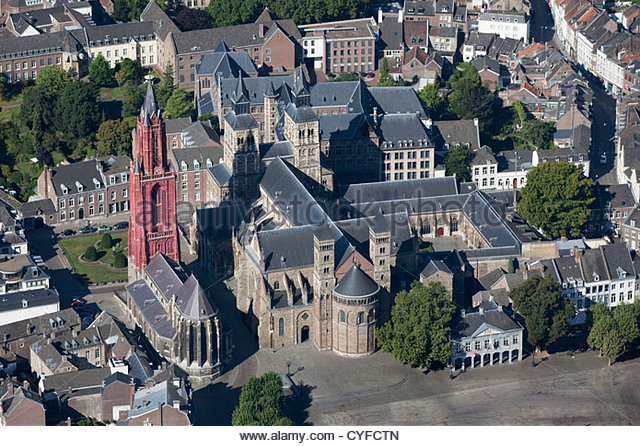 Church called St Servatius Basilica, the oldest church of the country. Church left with red tower called St Jans. - Stock Image