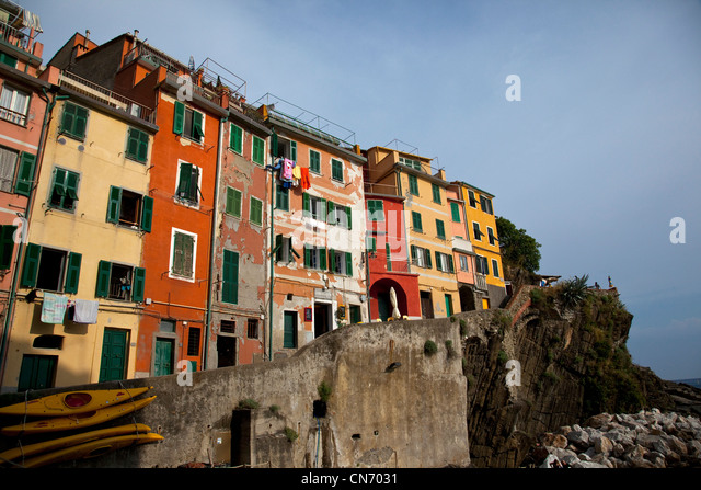 The colorful and weather worn buildings of Riomaggiore, one of the cities along the Cinque Terre, Italy. - Stock Image