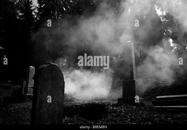 Romania - Transylvania, Sighişoara Graveyard. Fog among the graves - Stock Image