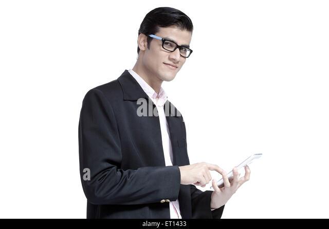 Man Handling Tablet India Asia MR#790E - Stock Image