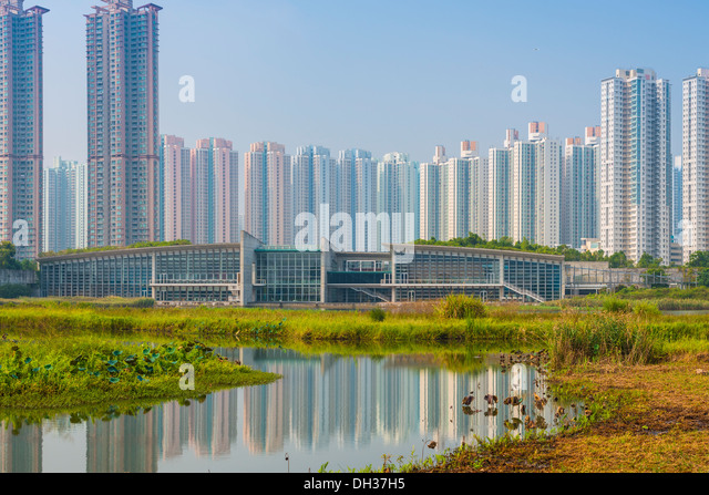 Hong Kong residential high rise cityscape viewed from Wetland Park. - Stock Image