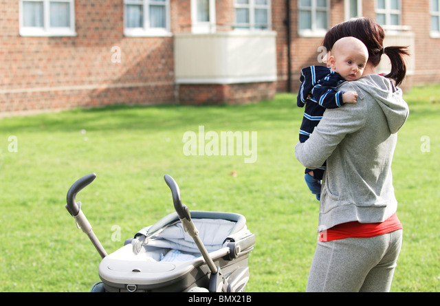 single mother with baby - Stock-Bilder
