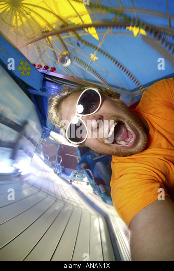 crazy young man driving roller coaster on the Crange fun fair, Germany, North Rhine-Westphalia, Ruhr Area, Herne - Stock Image