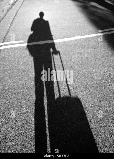 Long Shadow with bag - Stock Image