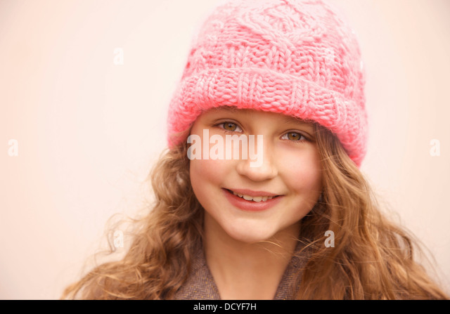 Smiling Young Girl Wearing Pink Wool Hat - Stock Image