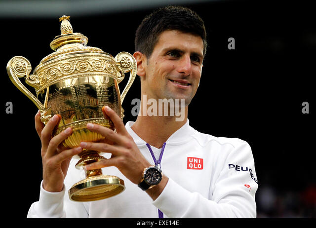 London, London, UK. 12th July, 2015. Novak Djokovic of Serbia poses with the trophy after the men's singles - Stock-Bilder