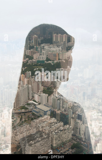 Businesswoman and Hong Kong cityscape, composite image - Stock-Bilder