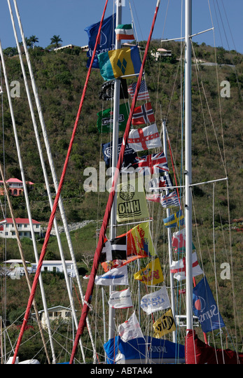 BVI Tortola Frenchman's Cay Soper's Hole Wharf and Marina boat masts flags - Stock Image