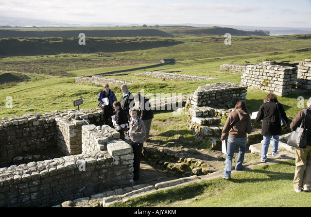 England UK Hexham Hadrians Hadrian's Wall Housesteads Roman Fort National Trust built AD122 group tour - Stock Image