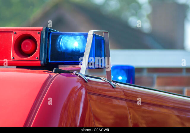 close-up picture of blue lights and sirens on a fi - Stock Image