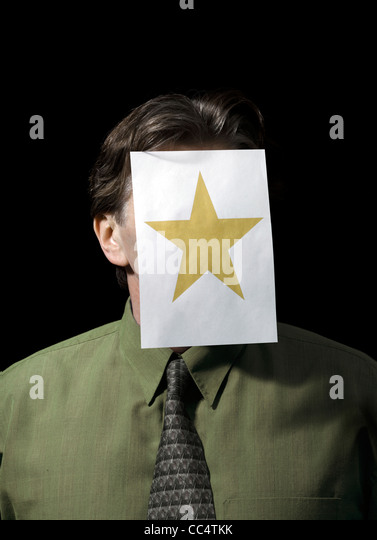 Portrait of a Businessman with Paper star on Face - Stock Image