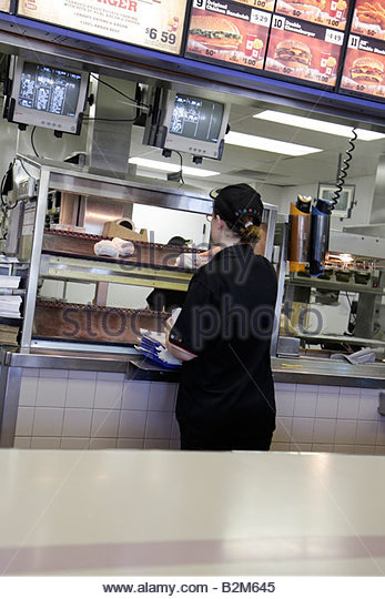 Michigan Grandville Burger King restaurant fast food counter woman worker job global chain franchise service order - Stock Image