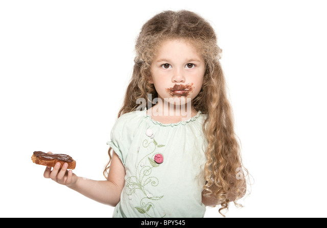 caucasian little girl portrait eat chocolate grubby isolated studio on white background - Stock-Bilder