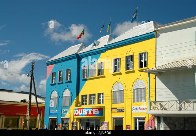 St Kitts Caribbean West Indies Basseterre shopping colorful stores - Stock Image