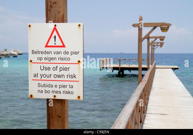 Curaçao Netherlands Antilles Dutch Piscadera Bay Hilton Curaçao hotel resort Caribbean Sea wooden pier - Stock Image
