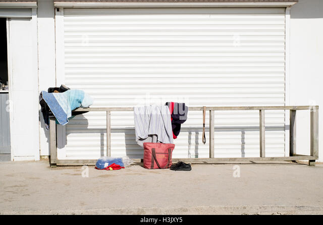 Swimmers at Falmouth's Gyllyngvase Beach leave their clothes by the cafe 23rd February 2016 - Stock Image
