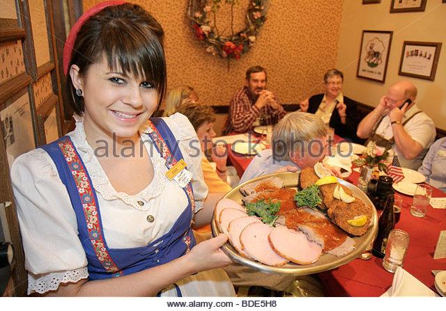 Michigan Frankenmuth Bavarian Inn Restaurant German ethnic community woman waitress job traditional dress dirndl - Stock Image