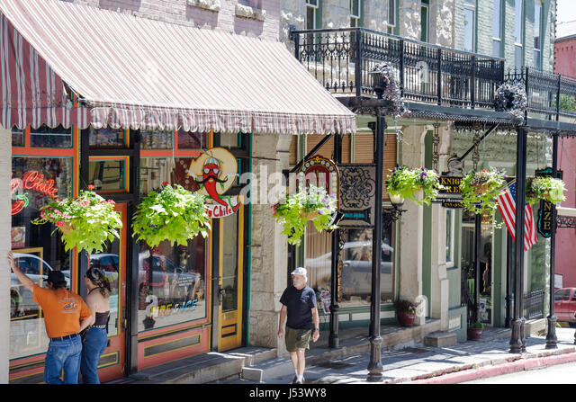 Arkansas Eureka Springs Spring Street historic building renovated awning shopping man woman couple specialty shops - Stock Image