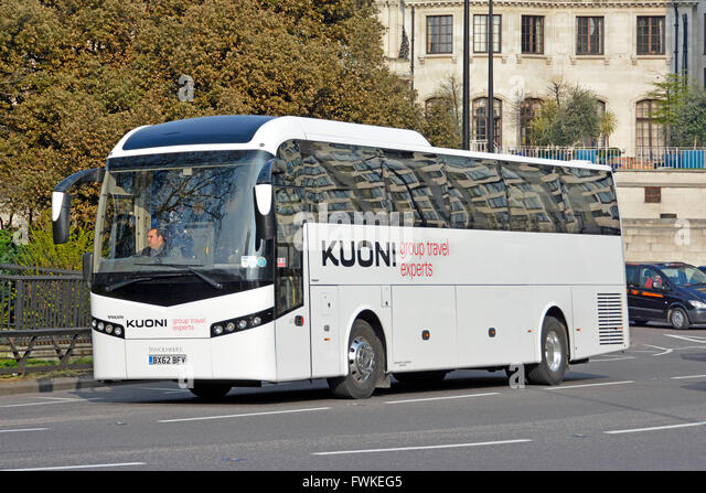 Driver & Kuoni group travel holiday tour company Volvo coach driving along Park Lane London England UK - Stock-Bilder