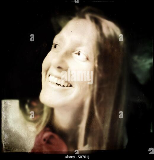 A young woman smiling - Stock Image
