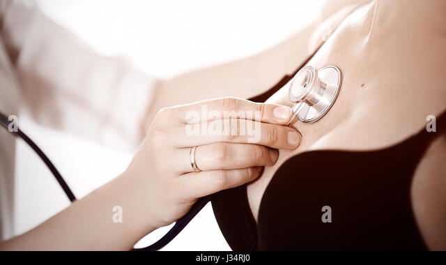 female medicine doctor holding stethoscope to pregnant woman standing for encouragement, empathy, cheering,support, - Stock Image