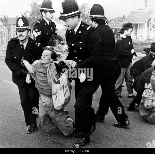 Female protesters backing the picketing miners are forcibly removed by Police at Port Talbot Steelworks. (4th July - Stock-Bilder