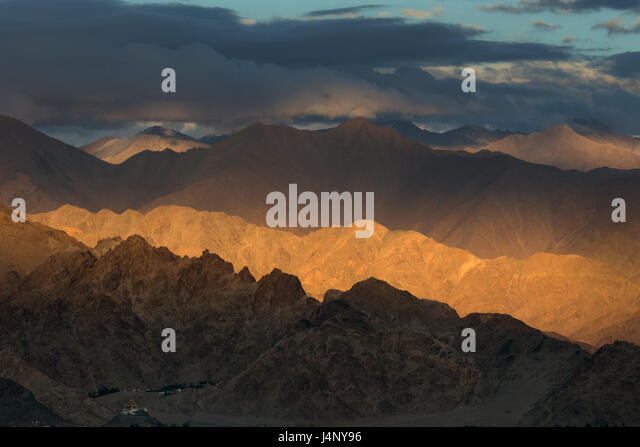 Summer evening in the high mountains, twilight, the sun's rays create a tonal perspective from dark brown to - Stock Image