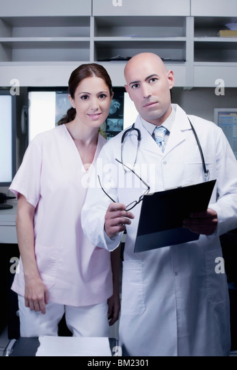 Portrait of two doctors with a medical report - Stock Image