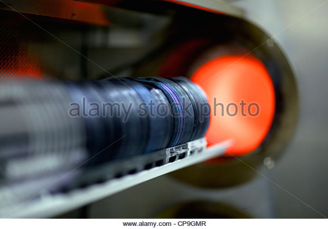 Close up of silicon wafers being processed in machine - Stock Image