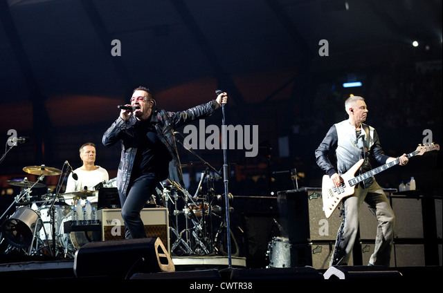 Larry Mullen Jr, Bono and Adam Clayton performing during The U2 360° Tour at Hampden Park, Glasgow - Stock Image